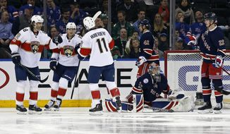 Florida Panthers left wing Jonathan Huberdeau (11) is congratulated by Panthers center Aleksander Barkov (16) and Panthers right wing Jaromir Jagr (68) after scoring a goal past New York Rangers goalie Antti Raanta (32) during the second period of an NHL hockey game, Friday, March 17, 2017, in New York. (AP Photo/Adam Hunger)