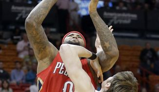 New Orleans Pelicans forward DeMarcus Cousins (0) prepares to shoot as Miami Heat forward Luke Babbitt (5) defends in the first half of an NBA basketball game, Wednesday, March 15, 2017, in Miami. (AP Photo/Alan Diaz)