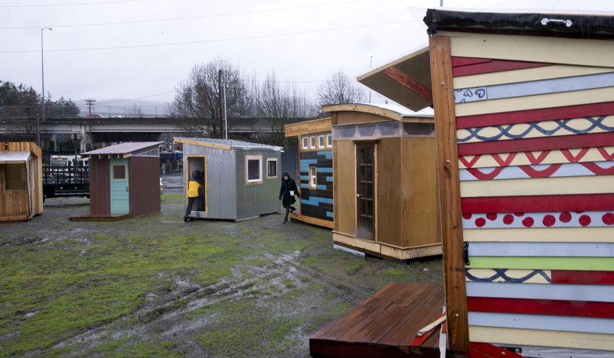 "FILE--In this March 7, 2017, file photo, tiny living pods for the Kenton Neighborhood Tiny Home Pilot houses are viewed in Portland, Ore. The affordable housing crisis in Portland and the accompanying homeless problem has gotten so bad that local officials are thinking outside the box with similar plans to build ""tiny houses"" for homeless families and place them in the backyards of willing residents. (Beth Nakamura/The Oregonian via AP, File)"
