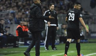 """In this photo taken Wednesday, Feb. 22, 2017, FC Porto's Brazilian player Francisco Soares """"Tiquinho"""" walks past his coach Nuno Espirito Santo during the Champions League round of 16, first leg, soccer match between FC Porto and Juventus at the Dragao stadium in Porto, Portugal. The Brazilian striker, Soares, a new sensation in Portuguese soccer who earned his """"Tiquinho"""" nickname for being too small, is about to become the new Hulk for FC Porto. (AP Photo/Paulo Duarte)"""