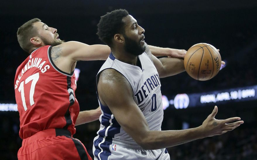 Detroit Pistons center Andre Drummond (0) is fouled by Toronto Raptors center Jonas Valanciunas (17) while going to the basket during the first half of an NBA basketball game Friday, March 17, 2017, in Auburn Hills, Mich. (AP Photo/Duane Burleson)