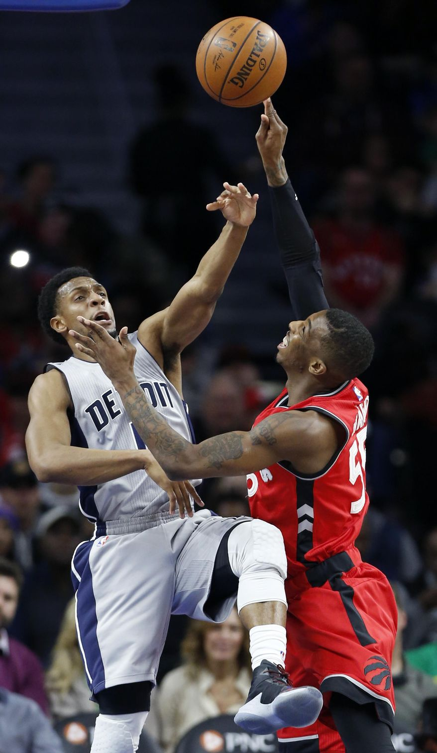 Detroit Pistons guard Ish Smith, left, blocks a shot by Toronto Raptors guard Delon Wright during the first half of an NBA basketball game Friday, March 17, 2017, in Auburn Hills, Mich. (AP Photo/Duane Burleson)