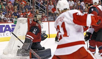 Arizona Coyotes goalie Mike Smith (41) makes a save on a shot by Detroit Red Wings left wing Tomas Tatar (21) during the second period of an NHL hockey game Thursday, March 16, 2017, in Glendale, Ariz. (AP Photo/Ross D. Franklin)