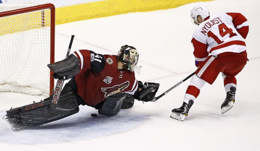 Detroit Red Wings right wing Gustav Nyquist (14) scores a goal against Arizona Coyotes goalie Mike Smith (41) during the shootout of an NHL hockey game Thursday, March 16, 2017, in Glendale, Ariz. The Red Wings defeated the Coyotes 5-4. (AP Photo/Ross D. Franklin)