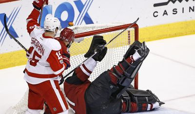 Arizona Coyotes goalie Mike Smith, right, gives up a goal to Detroit Red Wings' Dylan Larkin as Red Wings' Riley Sheahan (15) and Coyotes' defenseman Alex Goligoski (33) look on during the first period of an NHL hockey game Thursday, March 16, 2017, in Glendale, Ariz. (AP Photo/Ross D. Franklin)