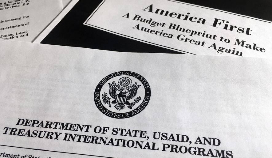 FILE - In this Wednesday, March 15, 2017 file photo, a portion of President Donald Trump's first proposed budget, focusing on the Department of State, USAID and Treasury International Programs, and released by the Office of Management and Budget, is photographed in Washington. President Donald Trump's proposed deep cuts in foreign aid could mark the retreat of U.S. support for South Sudan, a nation America enthusiastically helped to create. (AP Photo/Jon Elswick, File)