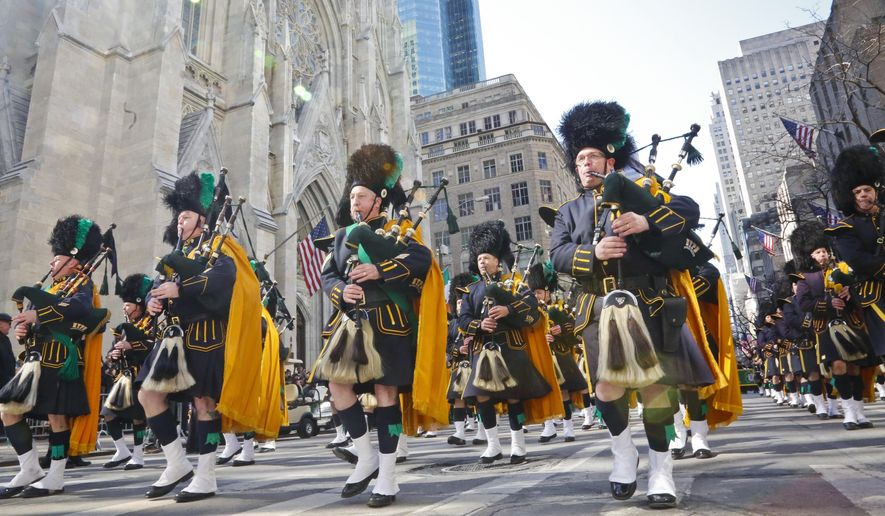 In this file photo, NYPD Emerald City bagpipes march during the St. Patrick's Day Parade, Friday March 17, 2017, at St. Patrick's Cathedral in New York. (AP Photo/Bebeto Matthews) **FILE**