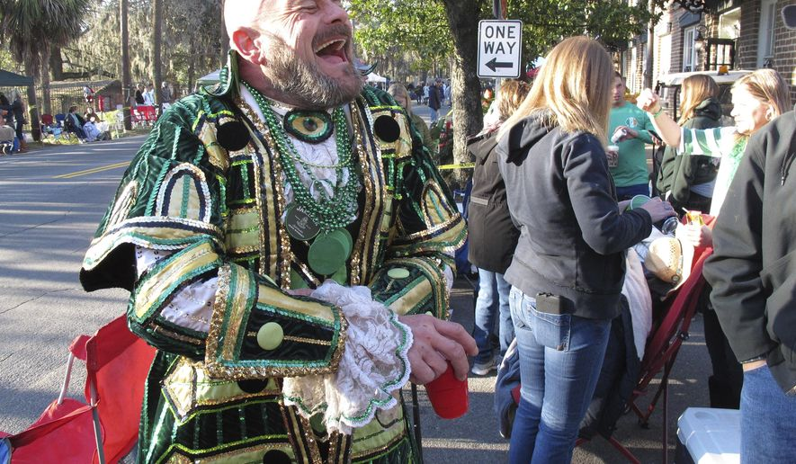 Brian Welzenbach laughs with friends Friday, March 17, 2017, while celebrating St. Patrick's Day in Savannah, Ga. The coastal city has been celebrating the Irish holiday since 1824, and now thousands come each year for one of the South's largest street parties after Mardi Gras. (AP Photo/Russ Bynum)