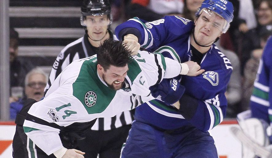 Dallas Stars' Jamie Benn (14) fights Vancouver Canucks' Nikita Tryamkin (88) during the second period of an NHL hockey game Thursday, March 16, 2017, in Vancouver, British Columbia. (Ben Nelms/The Canadian Press via AP)