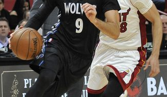 Minnesota Timberwolves' Ricky Rubio (9) on the drive downcourt against the Miami Heat during the first quarter of an NBA basketball game Friday, March 17, 2017, in Miami. (AP Photo/Gaston De Cardenas)
