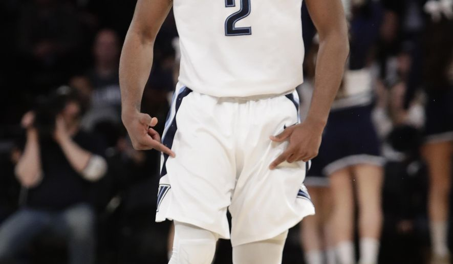 In this March 11, 2017 file photo, Villanova's Kris Jenkins (2) reacts after making a three point basket during the first half of a championship NCAA college basketball game against Creighton in the finals of the Big East men's tournament in New York. Top-seeded Villanova faces No. 8 seed Wisconsin in the second round of the East region on Saturday, March 18. (AP Photo/Frank Franklin II, File)