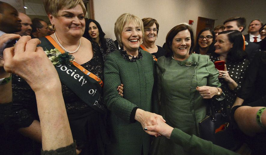 "Guest speaker Hillary Clinton greets supporters after her speech during the the Society of Irish Women annual dinner on St. Patrick's Day, Friday, March 17, 2017, in Scranton, Pa. Clinton says she's ""ready to come out of the woods"" and help Americans find common ground. She urged a divided country to work together to solve problems, recalling how, as first lady, she met with female leaders working to bring peace to Northern Ireland. (Butch Comegys/The Times & Tribune via AP)"