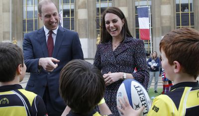 Britain's Prince William, Duke of Cambridge, and his wife Kate, Duchess of Cambridge meet young French rugby fans at the Trocadero square, in Paris, Saturday, March 18, 2017 to (AP Photo/Michel Euler, Pool)