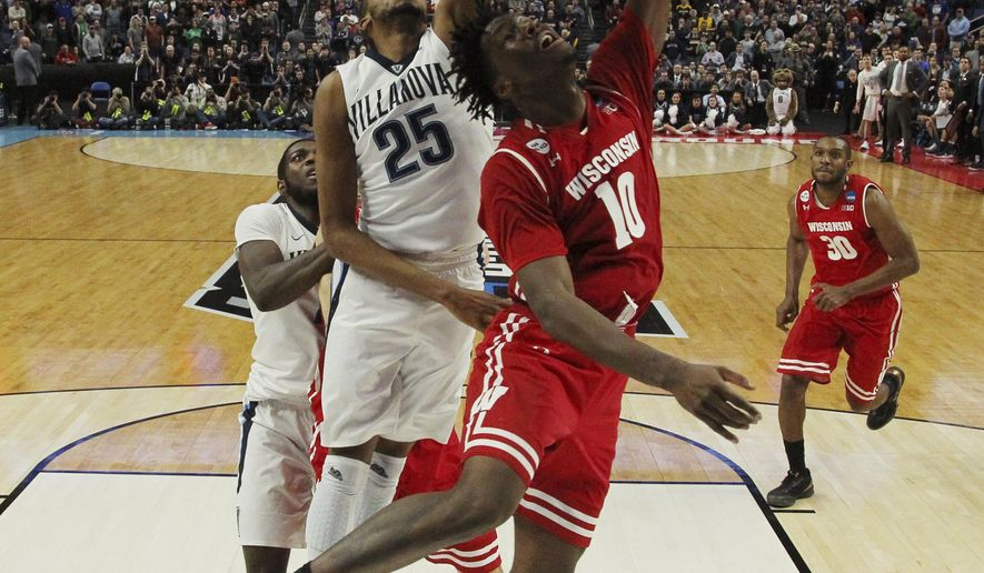 Wisconsin forward Nigel Hayes (10) scores the game-winning basket against Villanova guard Mikal Bridges (25) with 11 seconds to play in the second half of a second-round men's college basketball game in the NCAA Tournament, Saturday, March 18, 2017, in Buffalo, N.Y. Wisconsin won, 65-62. (AP Photo/Bill Wippert)