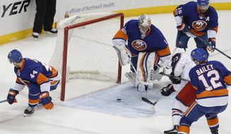 Columbus Blue Jackets right wing Cam Atkinson (13) shoots and scores the winning goal past New York Islanders goalie Thomas Greiss (1) in overtime of an NHL hockey game, Saturday, March 18, 2017, in New York. The Blue Jackets won 3-2. (AP Photo/Julie Jacobson)