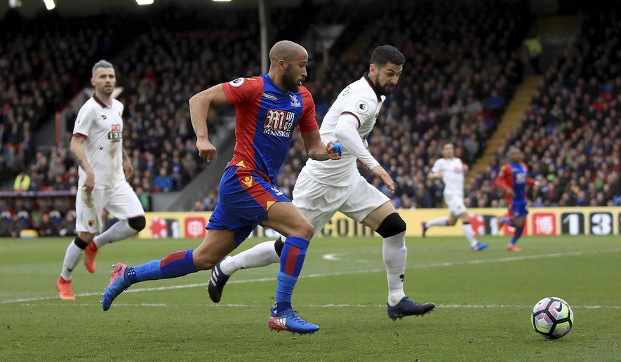 Crystal Palace's Andros Townsend, left, vies for the ball with Watford's Miguel Britos, during the English  Premier League soccer match between Crystal Palace and Watford, at Selhurst Park, in  London, Saturday March 18, 2017. (John Walton/PA via AP)