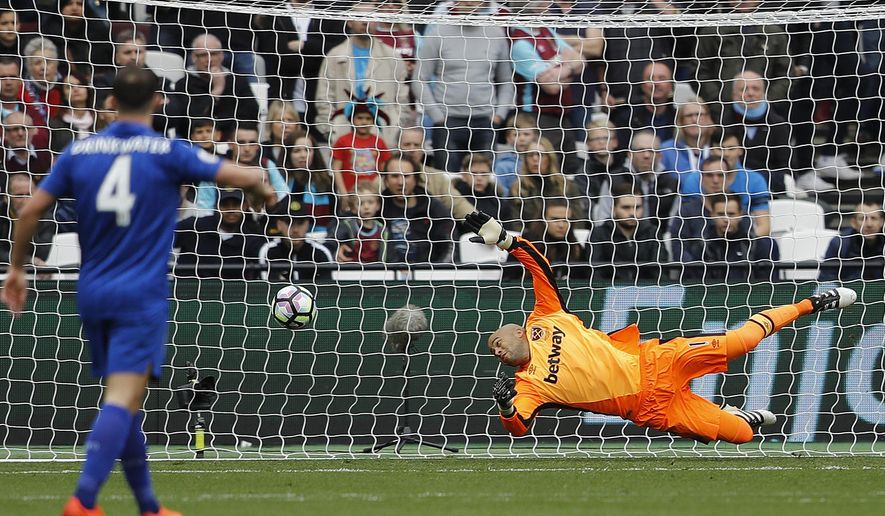 West Ham's goalkeeper Darren Randolph fails to save a shot by Leicester's Riyad Mahrez during the English Premier League soccer match between West Ham and Leicester City at London Stadium in London, Saturday, March 18, 2017. (AP Photo/Frank Augstein)
