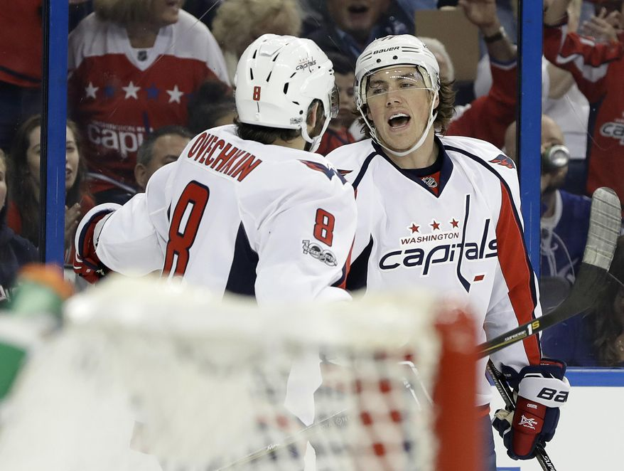 Washington Capitals right wing T.J. Oshie, right, celebrates with left wing Alex Ovechkin after scoring against the Tampa Bay Lightning during the first period of an NHL hockey game Saturday, March 18, 2017, in Tampa, Fla. (AP Photo/Chris O'Meara)