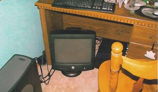 This image provided by the Lacey Police Department shows a June 14, 2007, photo of a computer taken from the bedroom of the Timberline High School bomb hoaxer in Lacey, Wash. In 2007, a teenager who was sending bomb threats to his high school in Washington state was finally caught by an FBI agent posing as a journalist.  Local police raided the home hours after the FBI pinpointed his location using surveillance software. The Associated Press obtained a copy of the photo, taken by investigators, via a public records request. (Lacey Police Department via AP)