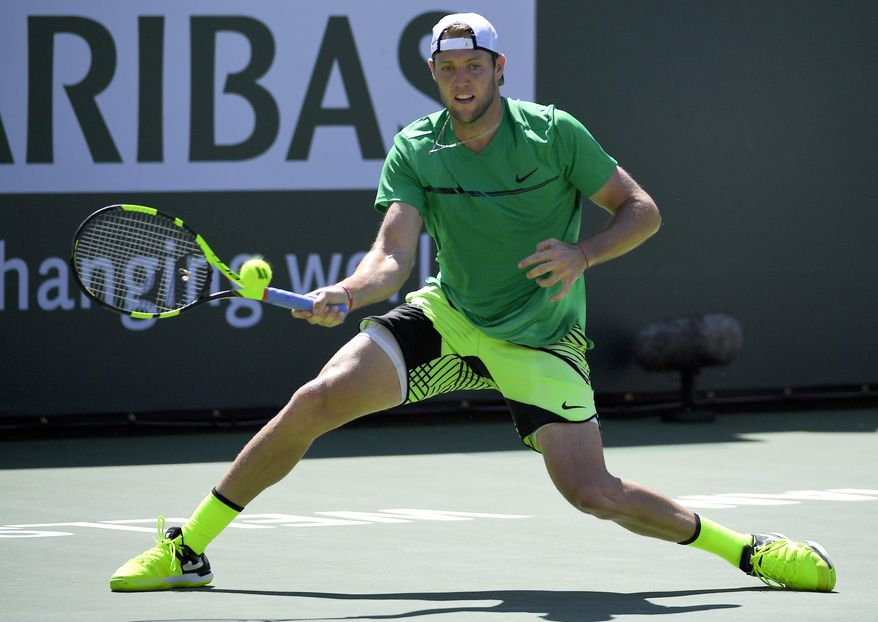 Jack Sock hits to Roger Federer, of Switzerland during a semifinal match at the BNP Paribas Open tennis tournament, Saturday, March 18, 2017, in Indian Wells, Calif. (AP Photo/Mark J. Terrill)
