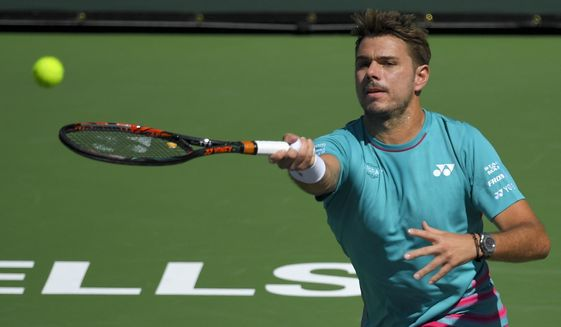 Stanislas Wawrinka, of Switzerland, hits to Pablo Carreno Busta, of Spain, during a semifinal match at the BNP Paribas Open tennis tournament, Saturday, March 18, 2017, in Indian Wells, Calif. (AP Photo/Mark J. Terrill)