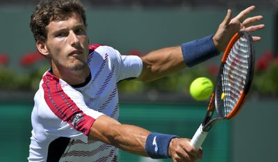 Pablo Carreno Busta, of Spain, hits to Stanislas Wawrinka, of Switzerland, during a semifinal match at the BNP Paribas Open tennis tournament, Saturday, March 18, 2017, in Indian Wells, Calif. (AP Photo/Mark J. Terrill)