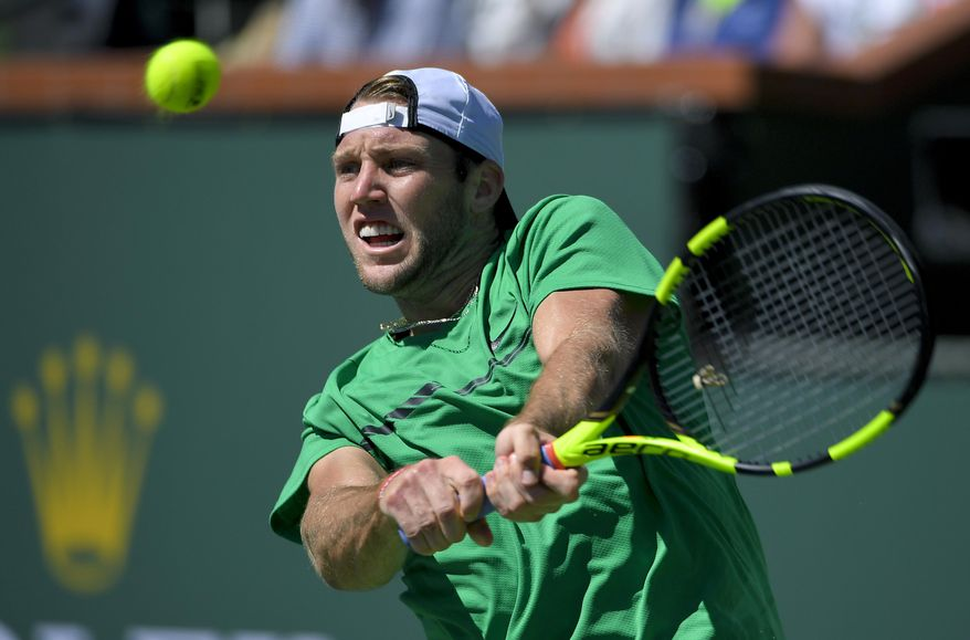 United States' Jack Sock hits to Roger Federer, of Switzerland, during a semifinal match at the BNP Paribas Open tennis tournament, Saturday, March 18, 2017, in Indian Wells, Calif. (AP Photo/Mark J. Terrill)