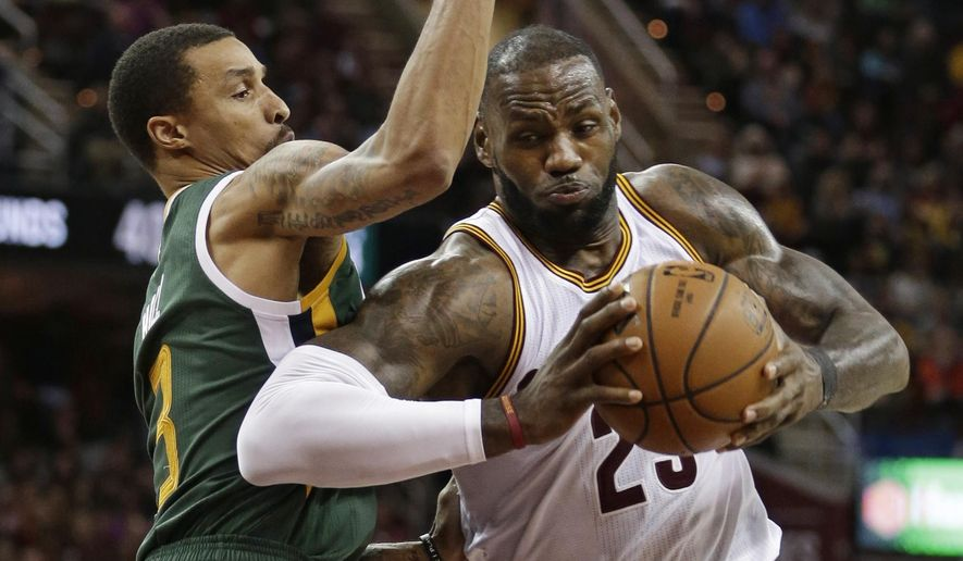 Cleveland Cavaliers' LeBron James, right, drives against Utah Jazz's George Hill in the second half of an NBA basketball game, Thursday, March 16, 2017, in Cleveland. The Cavaliers won 91-83. (AP Photo/Tony Dejak)