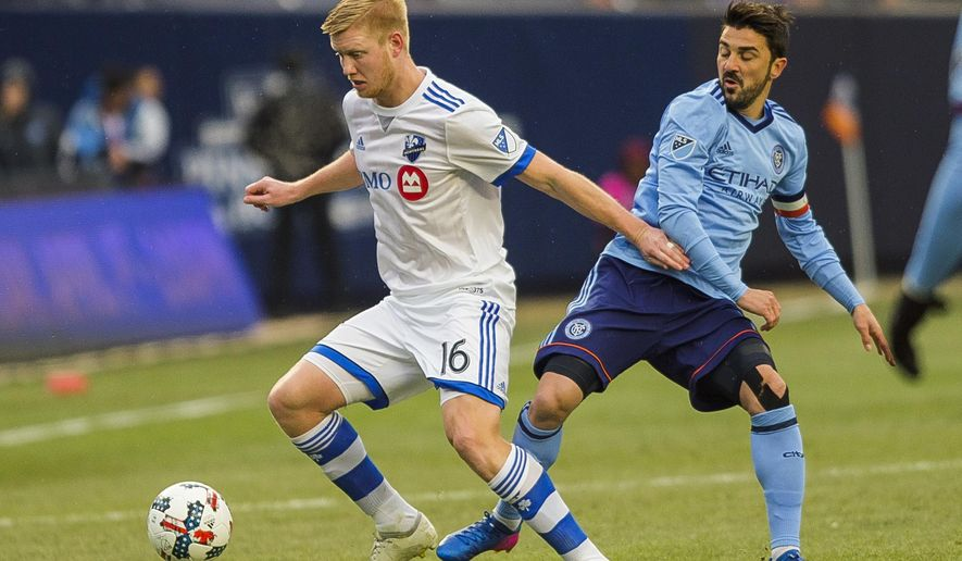 Montreal Impact's Calum Mallace, left, vies for the ball with New York City FC's David Villa, right, during an MLS Eastern Conference soccer match at Yankee Stadium in New York, Saturday, March 18, 2017. (AP Photo/Andres Kudacki)