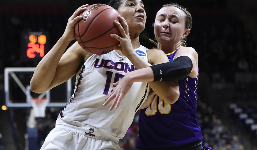 Albany's Mackenzie Trpcic, right, fouls Connecticut's Gabby Williams, left, during the first half of a first round round of a women's college basketball game in the NCAA Tournament, Saturday, March 18, 2017, in Storrs, Conn. (AP Photo/Jessica Hill)