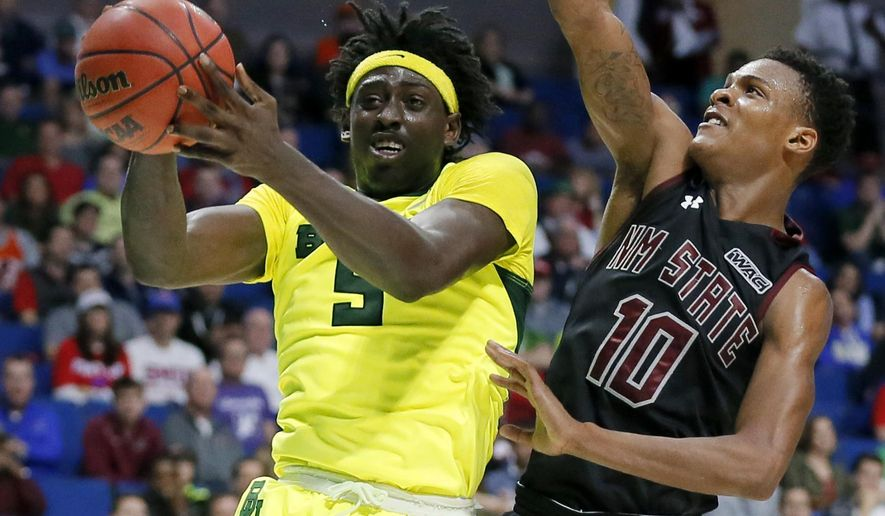 Baylor forward Johnathan Motley (5) goes up for a shot as New Mexico State's Jemerrio Jones defends in the second half of a first-round game in the men's NCAA college basketball tournament in Tulsa, Okla., Friday March 17, 2017. (AP Photo/Tony Gutierrez)