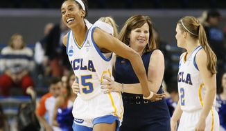 UCLA forward Monique Billings, left, and coach Cori Close, right, smile after UCLA defeated Boise State in a first-round game of the NCAA women's college basketball tournament, Saturday, March 18, 2017, in Los Angeles. (AP Photo/Danny Moloshok)