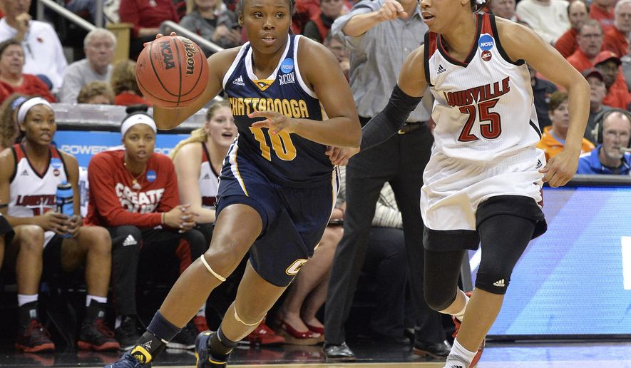 Chattanooga's Queen Alford (10) attempts to drive past the defense of Louisville's Asia Durr (25) in the first half of a first-round game in the women's NCAA college basketball tournament, Saturday, Mar. 18, 2017, in Louisville, Ky. (AP Photo/Timothy D. Easley)