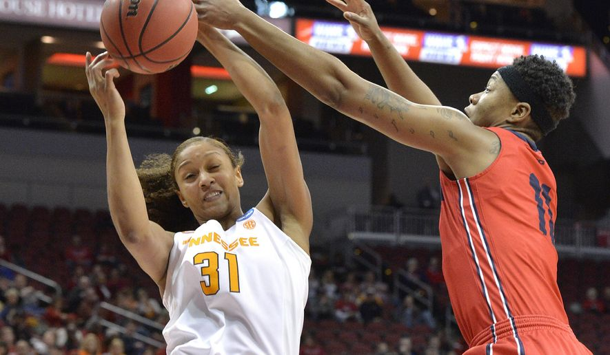 Tennessee's Jaime Nared (31) battles Dayton's Alex Harris (11) for a rebound in the first half of a first-round game in the women's NCAA college basketball tournament, Saturday, March 18, 2017, in Louisville, Ky. Louisville won 82-62. (AP Photo/Timothy D. Easley)