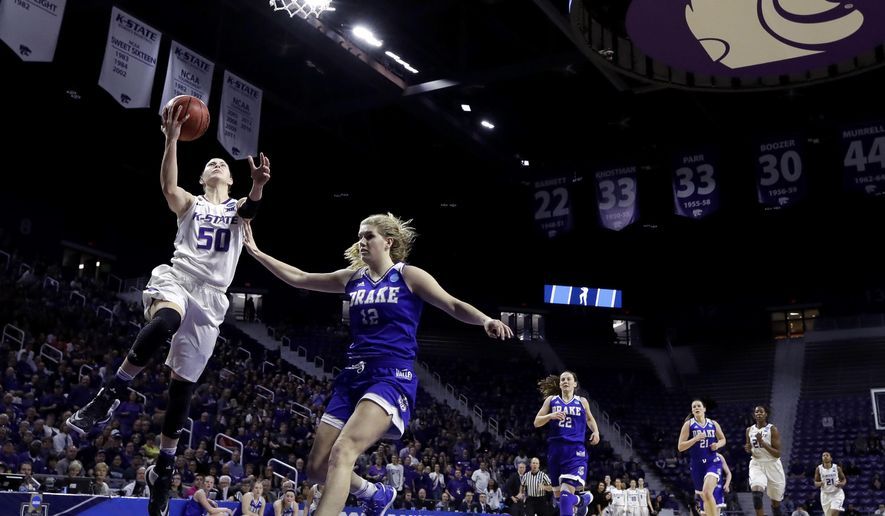 Kansas State's Shaelyn Martin (50) gets past Drake's Brenni Rose (12) to shoot during the first half of a first-round game in the NCAA women's college basketball tournament Saturday, March 18, 2017, in Manhattan, Kan. (AP Photo/Charlie Riedel)