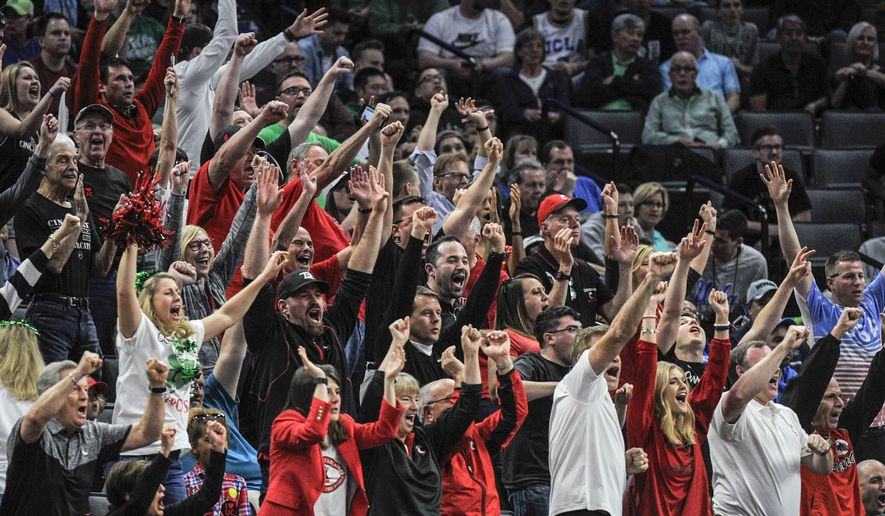 Cincinnati fans celebrate in the closing moments of the team's 65-61 win over Kansas State in a first-round game of the men's NCAA college basketball tournament in Sacramento, Calif., Friday, March 17, 2017. (AP Photo/Bryan Patrick)
