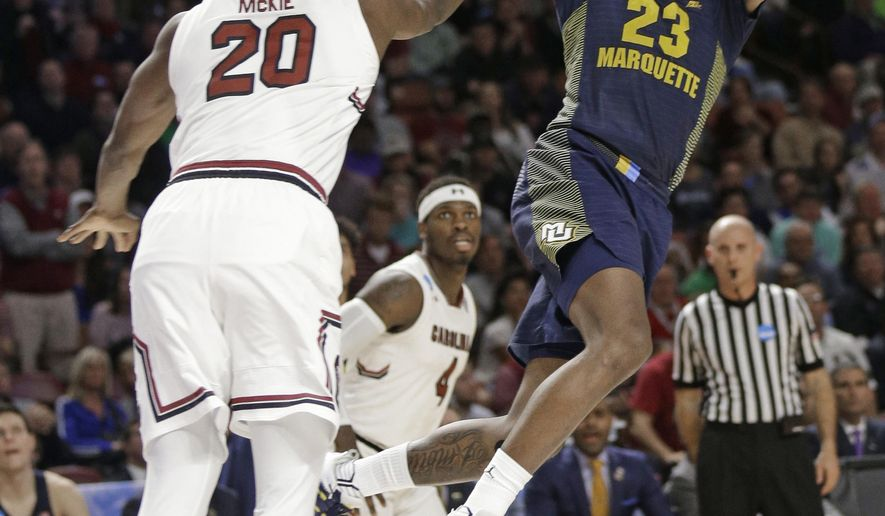 Marquette's Sacar Anim (2) shoots over South Carolina's Justin McKie (20) during the second half in a first-round game of the NCAA men's college basketball tournament in Greenville, S.C., Friday, March 17, 2017. (AP Photo/Chuck Burton)