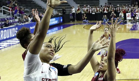 Stanford's Dijonai Carrington (21) gets past New Mexico State's Tyler Ellis (22) to put up a shot during the first half of a first-round game in the NCAA women's college basketball tournament Saturday, March 18, 2017, in Manhattan, Kan. (AP Photo/Charlie Riedel)