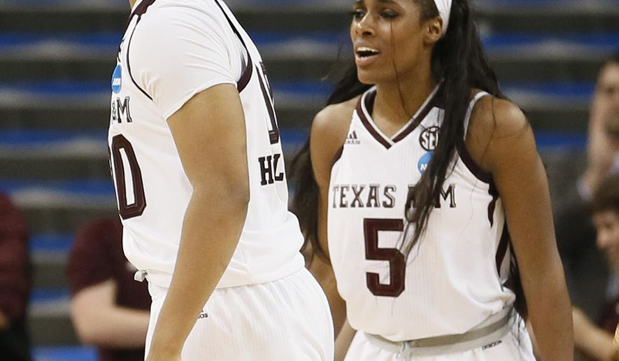 Texas A&M center Khaalia Hillsman, left, and forward Anriel Howard, right, celebrate after Penn made a turnover late in the second half of a first-round game in the NCAA women's college basketball tournament, Saturday, March 18, 2017, in Los Angeles. Texas A&M won 63-61. (AP Photo/Danny Moloshok)