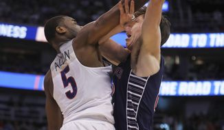 Arizona guard Kadeem Allen (5) blocks the shot of Saint Mary's forward Dane Pineau (22) during the first half of a second-round college basketball game in the men's NCAA Tournament, Saturday, March 18, 2017, in Salt Lake City. (AP Photo/George Frey)