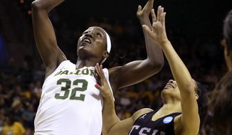 Baylor forward/center Beatrice Mompremier (32) rebounds against Texas Southern guard Chynna Ewing (12) in the first half of a first-round game in the women's NCAA college basketball tournament, Saturday, March 18, 2017, in Waco, Texas. (AP Photo/Jerry Larson)