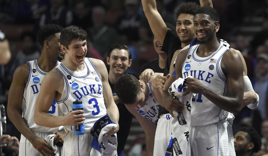 Duke players including Grayson Allen (3) and Amile Jefferson (21) celebrate during the second half against Troy in a first-round game of the NCAA men's college basketball tournament in Greenville, S.C., Friday, March 17, 2017. (AP Photo/Rainier Ehrhardt)