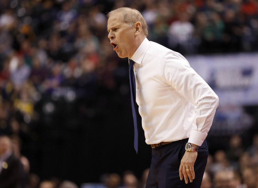 Michigan head coach John Beilein is seen on the sidelines during the first half of a first-round game against Oklahoma State in the men's NCAA college basketball tournament Friday, March 17, 2017, in Indianapolis, Mo. (AP Photo/Jeff Roberson)