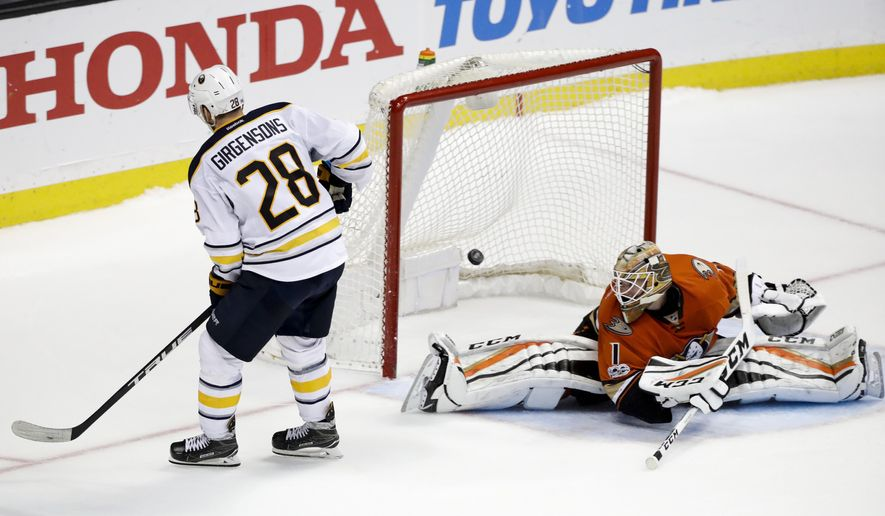 Buffalo Sabres' Zemgus Girgensons, left, of Latvia, scores against Anaheim Ducks goalie Jonathan Bernier during the shootout of an NHL hockey game Friday, March 17, 2017, in Anaheim, Calif. The Sabres won 2-1. (AP Photo/Jae C. Hong)