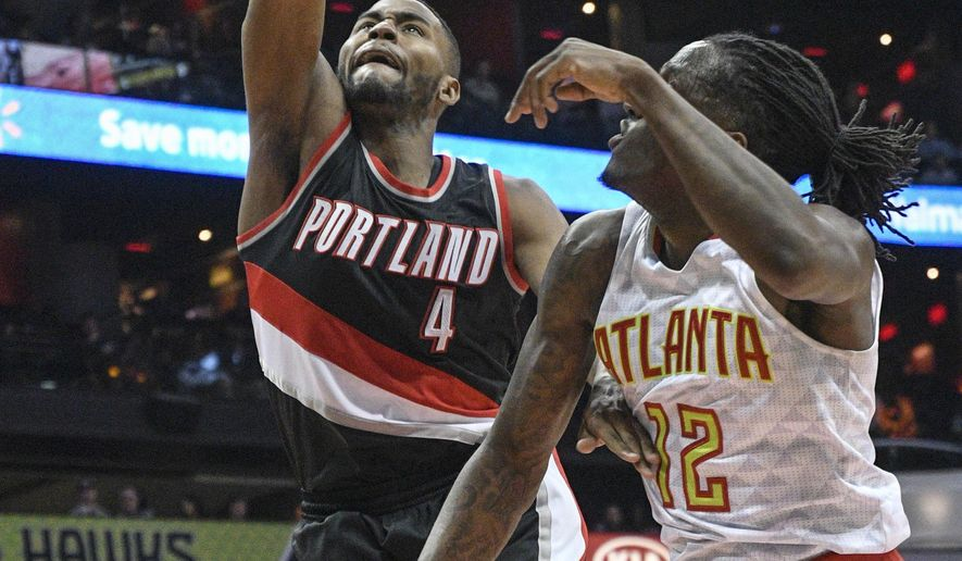 Portland Trail Blazers forward Maurice Harkless (4) shoots as Atlanta Hawks forward Taurean Prince (12) defends during the first half of an NBA basketball game, Saturday, March 18, 2017, in Atlanta. (AP Photo/John Amis)