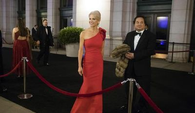 FILE - In this Thursday, Jan. 19, 2017 file photo, President-elect Donald Trump adviser Kellyanne Conway, center, accompanied by her husband, George, speaks with members of the media as they arrive for a dinner at Union Station in Washington, the day before Trump's inauguration. Trump has chosen George Conway to head the civil division of the Justice Department. The Wall Street Journal reports that he was chosen to head the office that has responsibility for defending the administration's proposed travel ban and defending lawsuits filed against the administration. The White House and the Justice Department would not confirm the pick Saturday, March 18, 2017. George Conway declined to comment. (AP Photo/Matt Rourke)