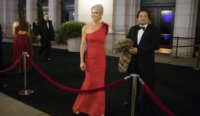 In this Thursday, Jan. 19, 2017 file photo, President-elect Donald Trump adviser Kellyanne Conway, center, accompanied by her husband, George, speaks with members of the media as they arrive for a dinner at Union Station in Washington, the day before Trump's inauguration. Trump has chosen George Conway to head the civil division of the Justice Department. The Wall Street Journal reports that he was chosen to head the office that has responsibility for defending the administration's proposed travel ban and defending lawsuits filed against the administration. The White House and the Justice Department would not confirm the pick Saturday, March 18, 2017. George Conway declined to comment. (AP Photo/Matt Rourke)