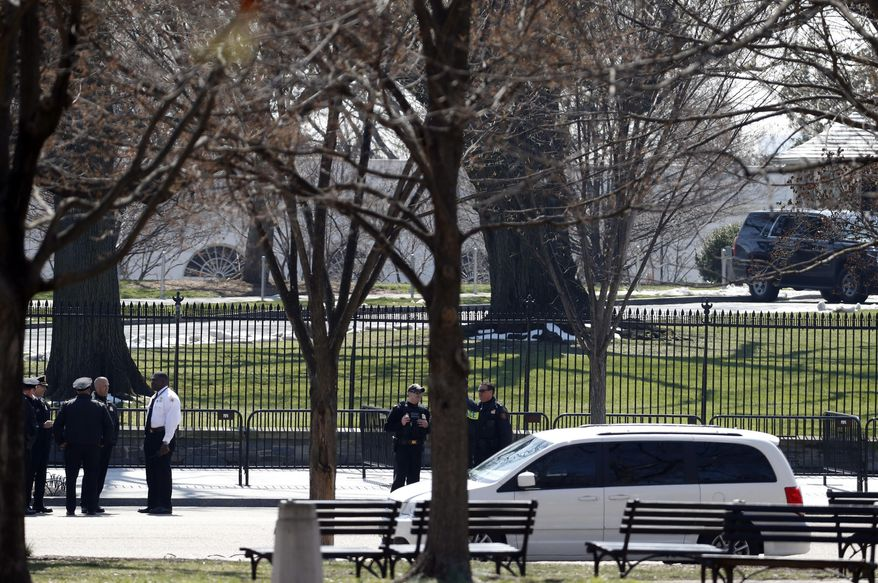 US Secret Service officers stand in the cordoned off area on Pennsylvania Avenue after a security incident near the fence of the White House in Washington, Saturday, March 18, 2017. President Trump was not at the White House at the time of the incident. (AP Photo/Alex Brandon)