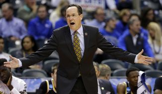 Wichita State head coach Gregg Marshall gestures from the bench during the first half of a first-round game against Dayton in the men's NCAA college basketball tournament in Indianapolis, Friday, March 17, 2017. (AP Photo/Michael Conroy)