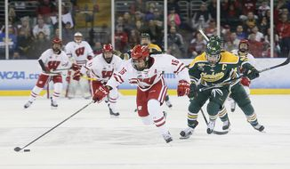 Wisconsin forward Sarah Nurse advances the puck on a shorthanded breakaway opportunity during the first period against Clarkson in the NCAA Division I Women's Frozen Four hockey championship game Sunday, March 19, 2017, in St. Charles, Mo. (Chris Lee/St. Louis Post-Dispatch via AP)